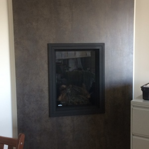 Neolith-Iron-Moss-fireplace-feature-wall