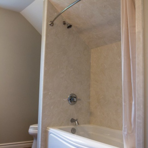 Coni-marble-tub-surround-with-sloped-ceiling